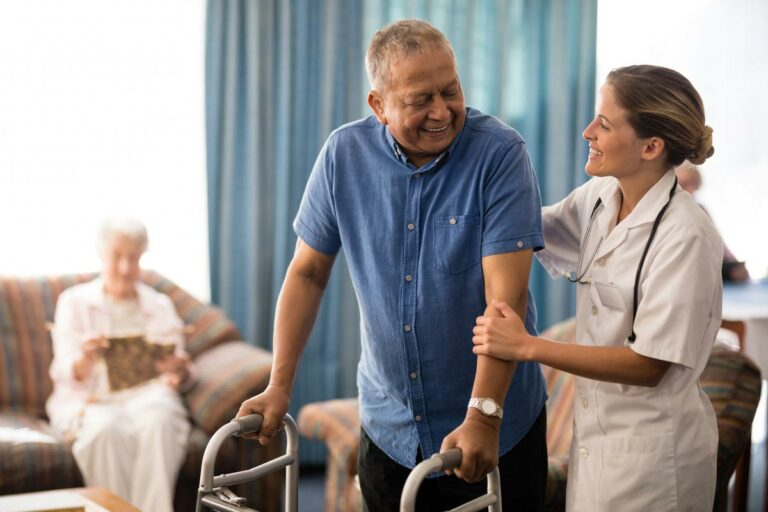 Proveer Senior Living | Senior man walking with the help of medical professional
