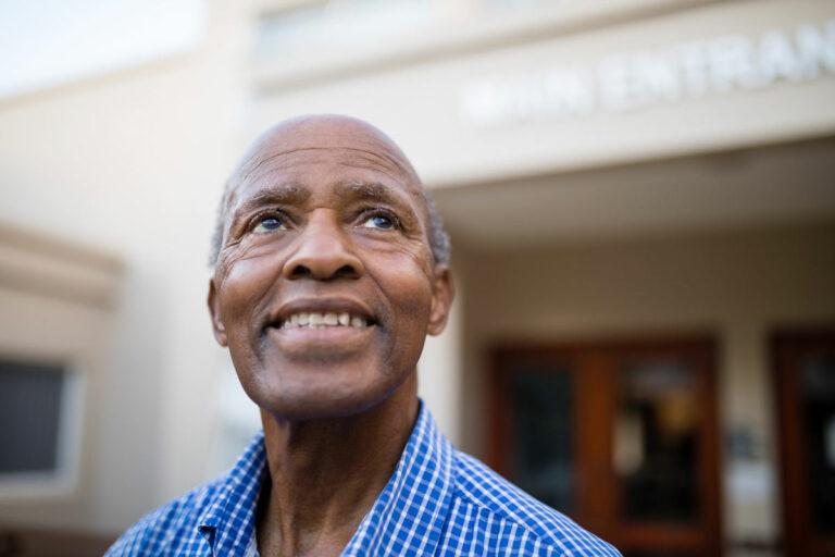 Proveer Senior Living | Senior man outside of building